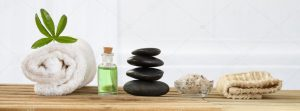 massage stones a towel and oil