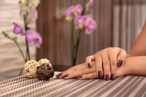 dark red manicure in a spa