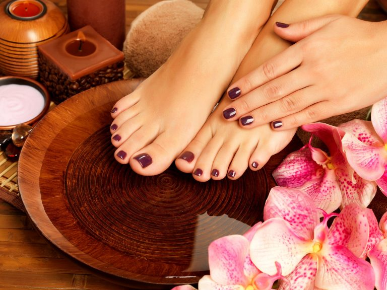 polished nails on hands and feet