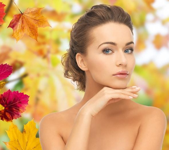 woman with beautiful skin on fall background