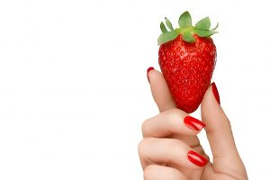strawberry held by a woman's hand with red fingernails horizontal flip (2)
