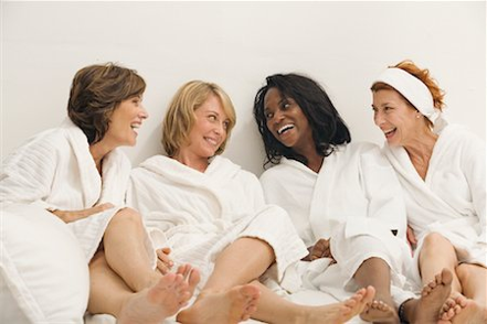 group of four ladies laughing at a spa
